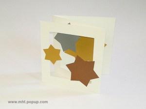 Cartes pop-up en triptyque accordéon, motifs étoiles or, argent et cuivre, vue de profil gauche
