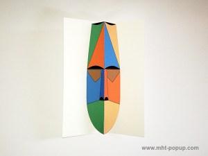 Carte pop-up Masque d'Afrique, modèle orange-bleu, vue de dessus