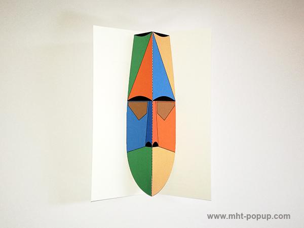 Carte pop-up Masque d'Afrique, modèle orange-bleu, vue de dessus. Format allongé
