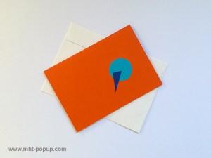 Carte pop-up Spirale motifs abstraits, orange-bleu clair, repliée avec enveloppe. Pièce unique signée