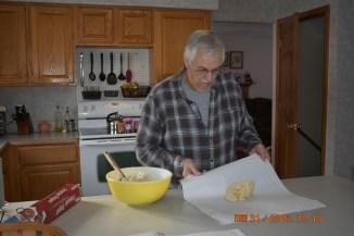Grandpa making Christmas cookies.