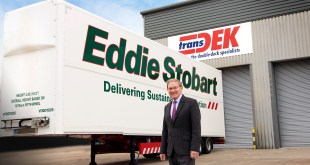 Transdek CEO and Founder Mark Adams in front of a Queens Award winning Wedge trailer