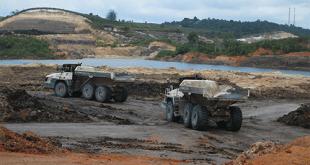Ten Terex Trucks TA400s shift soil in Indonesian mine