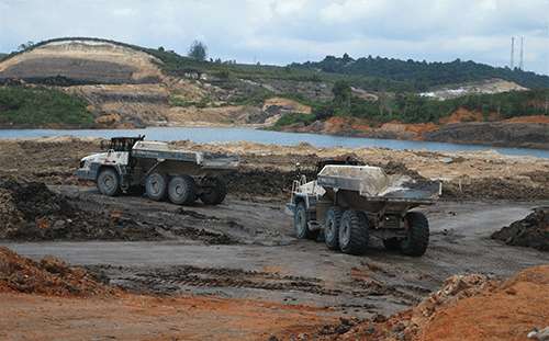 Ten Terex Trucks TA400s shift soil in Indonesian mine