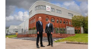 Simon Ayling and Adrian Coleman outside the extended Bunting-Redditch facility