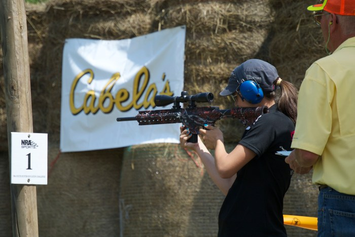 Lea shooting her Smith & Wesson M&P 15-.22 at the International YHEC competition