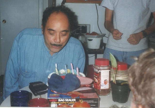 1986 Photo of Dad blowing out birthday candles