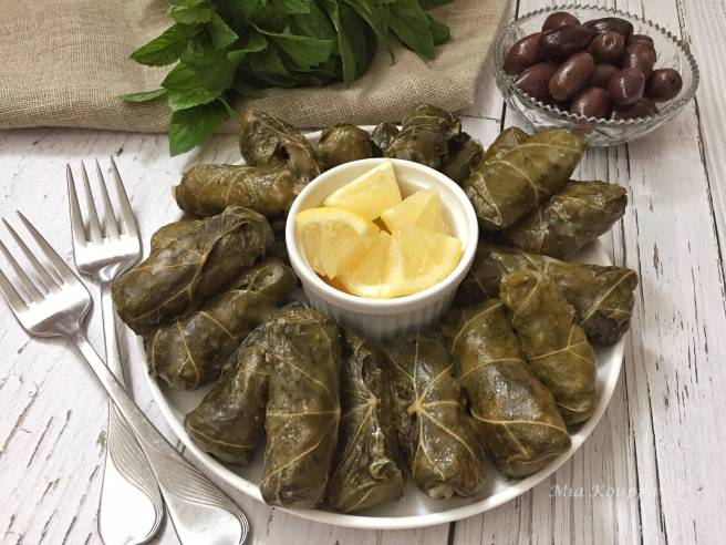 Greek dolmades. A mixture of rice and herbs wrapped in vine or grape leaves. A traditional and delicious Greek recipe.