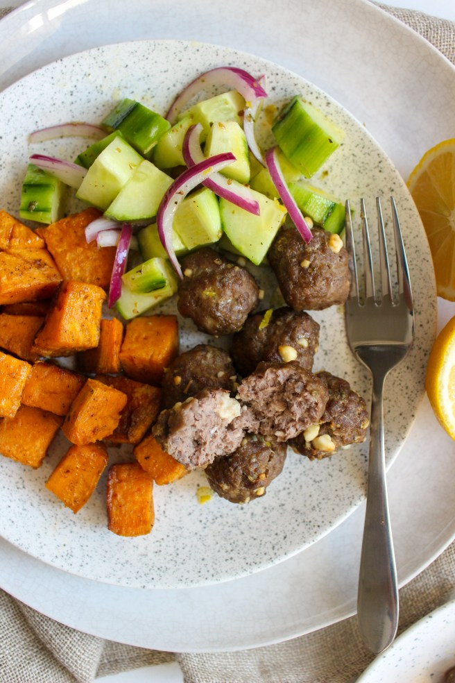 Feta-stuffed meatballs with olive and cucumber salad and roasted sweet potatoes