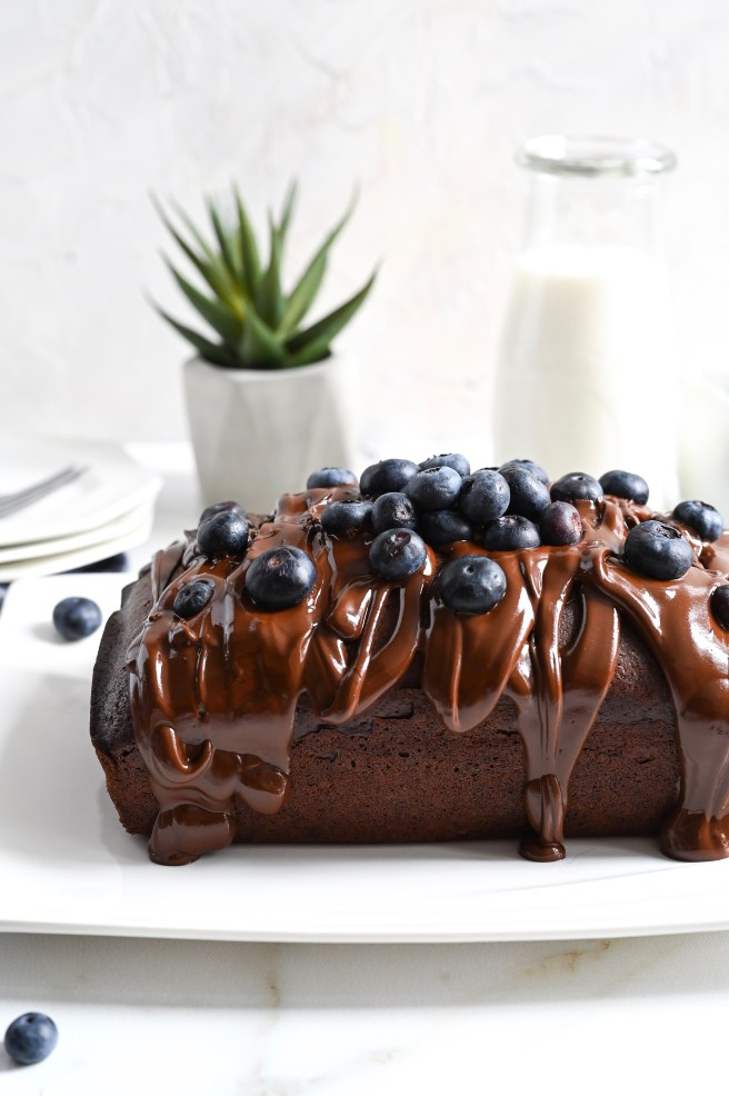 A vegan cake rich with chocolate flavour, blueberries and a chocolate glaze