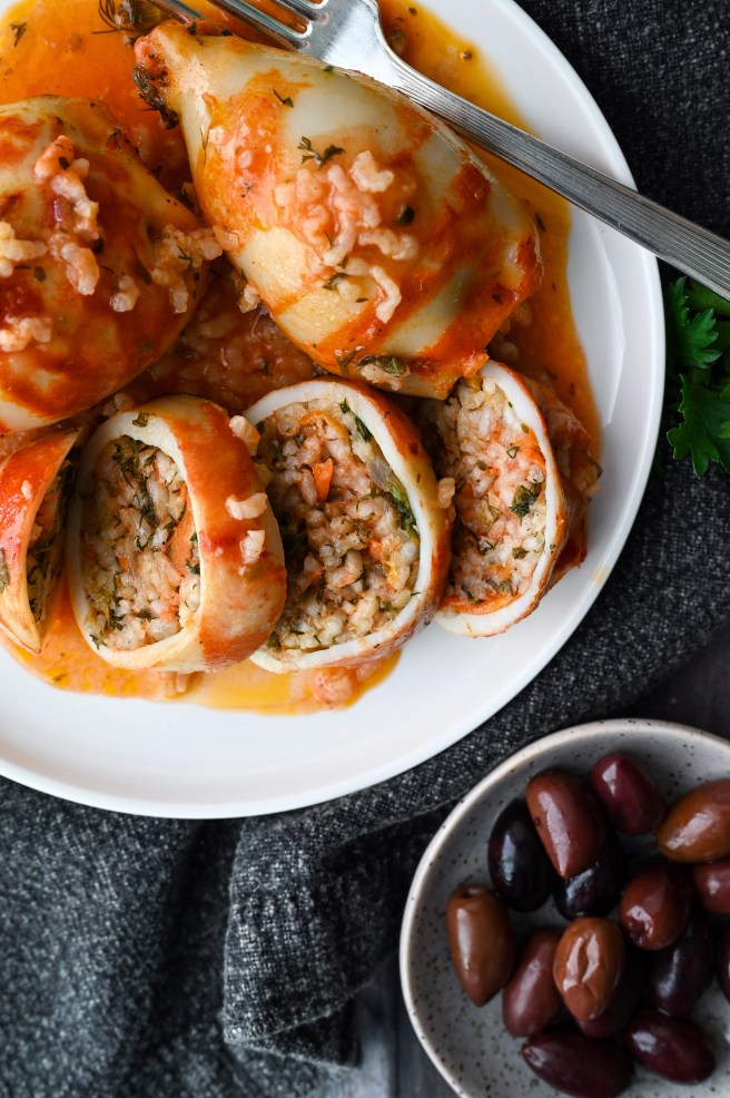 Baked squid stuffed with rice and herbs and baked in a tomato sauce.