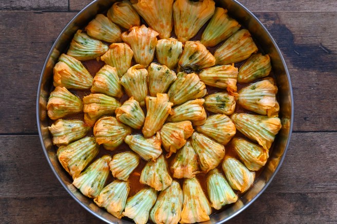 Stuffed zucchini flowers or blossoms are a vegan summer delight filled with rice, herbs and vegetables