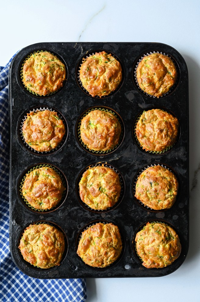 Savoury zucchini and cheddar muffins made with summer squash, aged cheddar and fresh herbs