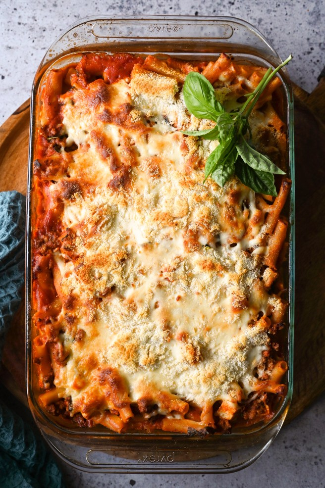 Easy baked ziti casserole with a Greek twist, full of cheese and a hearty meat sauce!