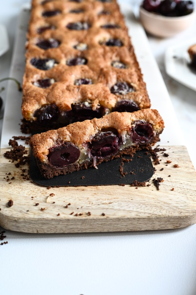 A cherry and coconut brown butter tart with a chocolate crust - pure decadence!