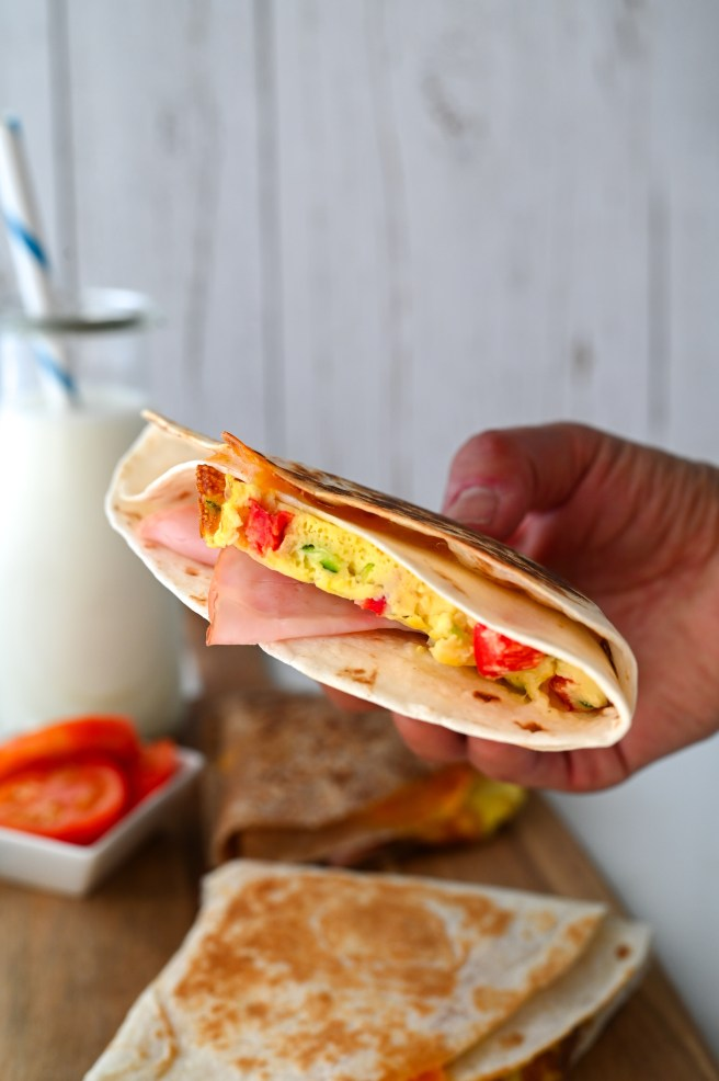 These easy breakfast tortilla wraps are full of eggs, veggies, cheese and ham for the best make-ahead meal!