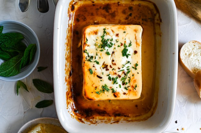 Baked feta with honey is a simple and delicious meze, perfect with crackers or bread.