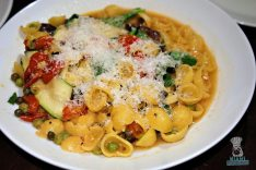 Apeiro - Orecchiette with Spinach, Zucchini, Kalamata Olives, Tomatoes, Peas, and Parmesan