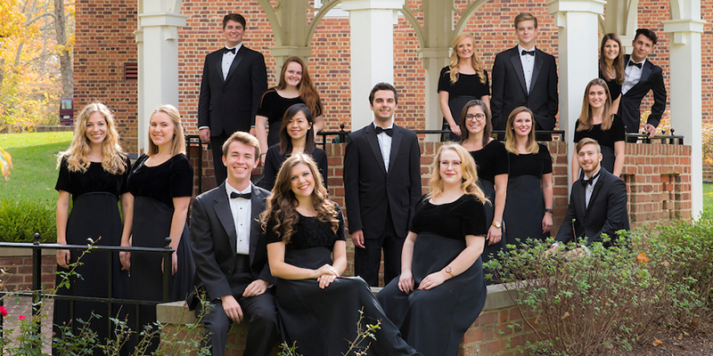 The Chamber Singers pose for a portrait outdoors