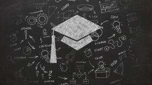 cap on chalkboard
