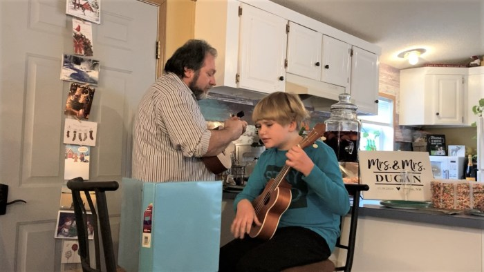 "Theo and I perform ""Somewhere Over the Rainbow"" on ukuleles for the newlyweds."