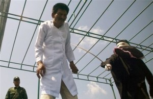 sharia-law-official-whips-a-man-convicted-of-gambling-with-a-rattan-cane-during-a-public-caning-in-aceh-besar-aceh-province-indonesia-friday-jan_-29-2010-300x194.jpg