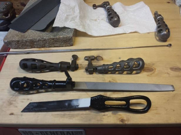 Selection of cast iron file handles and a pad saw handle. The pad saw handle works great with an old sawzall blade.