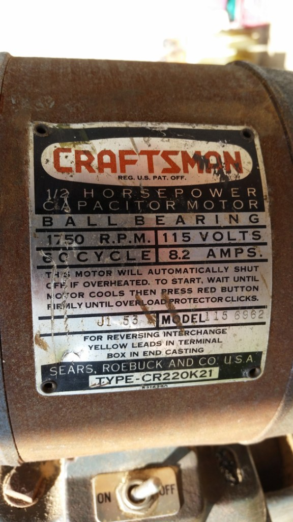 The 1/2 HP original Craftsman motor (115.6962 model, made by Packard). The J1 53 date code indicates this is a 1953 model.