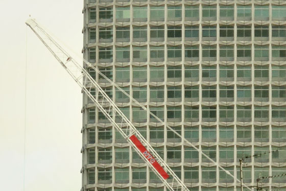 A building and a crane, London afternoon