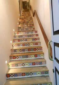 Some of the stairs going to second floor apartments or businesses are very colorful