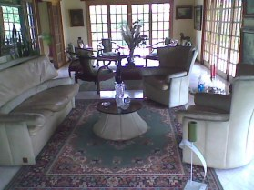 Large front room used for sitting and second dining room