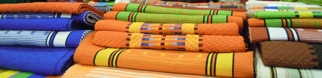 Very colorful tablecloths and place mats. All hand made