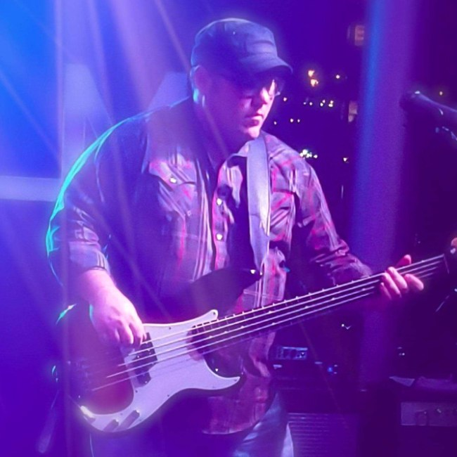 Michael Bess - bass guitar/backing vocals