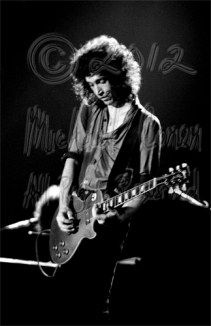 Mike Campbell playing a glass slide part