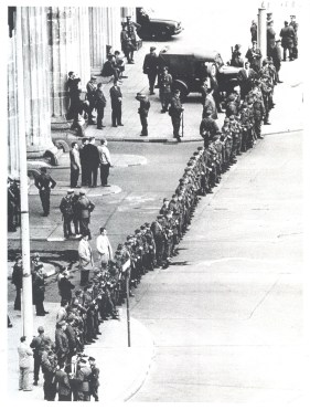 """East German infantrymen line-up in close ranks to seal off Berlin's key border crossing point, the Brandenburg Gate"" [from the USIA caption], 13 August 1961"