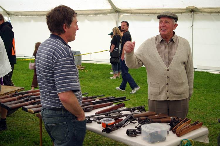 Dad discusses rifles with a vendor at Armistice in Cambridge