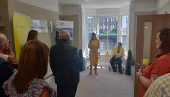 Paula Gelling speaking at the launch of Victim Support IOM, with Patron Elaine Christian in the background