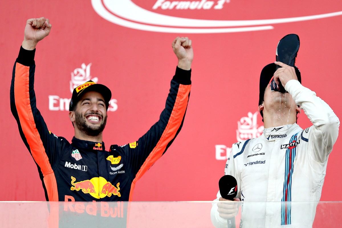 Daniel Ricciardo celebrates on the Azerbaijan Grand Prix podium with Lance Stroll.