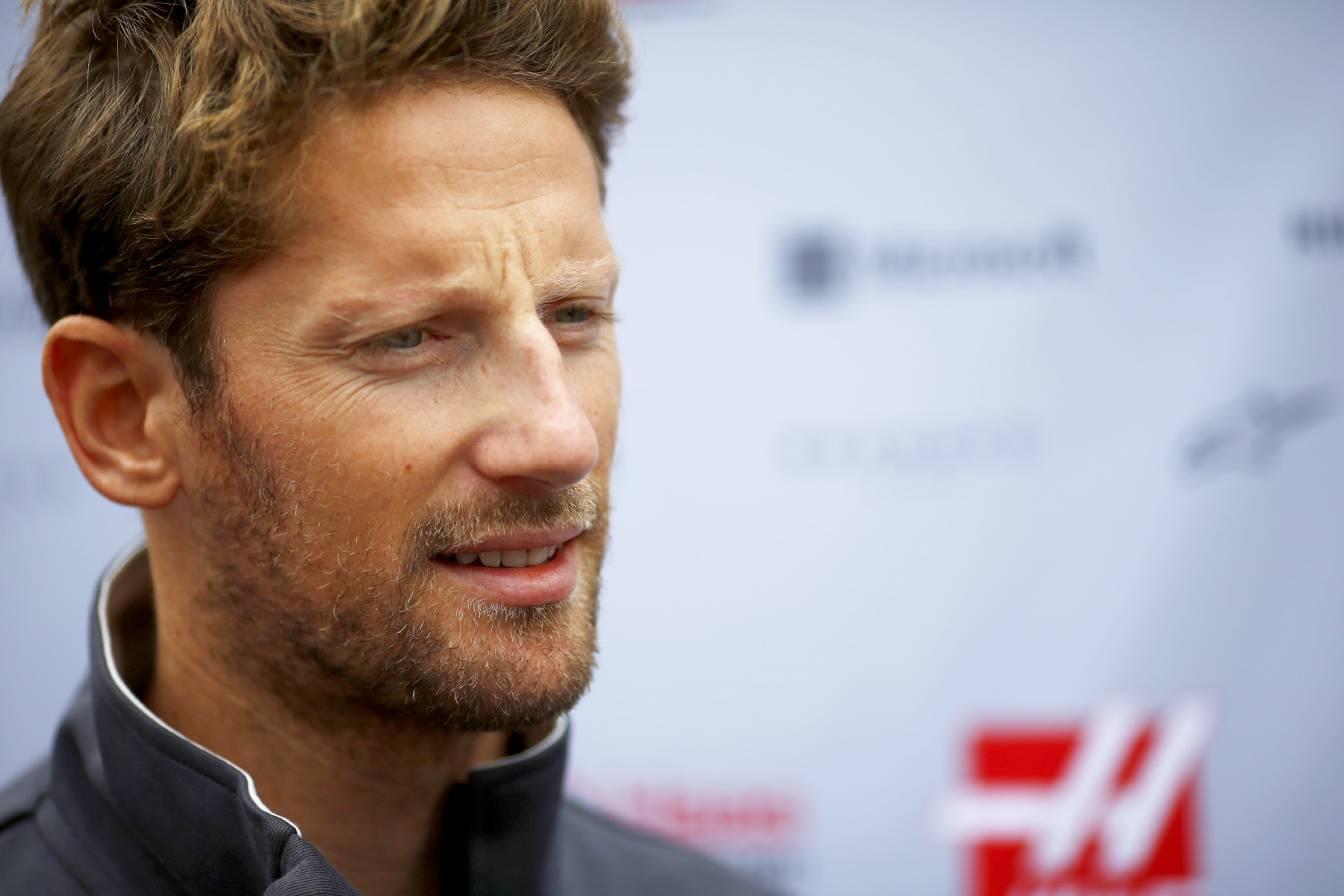 Romain Grosjean speaks to reporters at the 2017 Japanese Grand Prix.