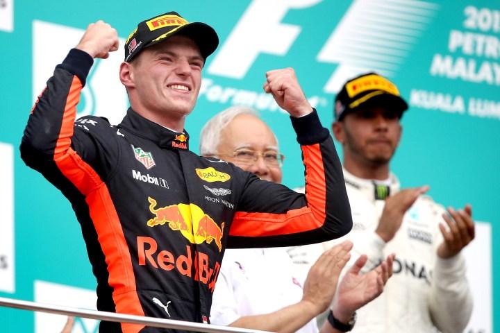 Max Verstappen celebrates on the 2017 Malaysian Grand Prix podium.