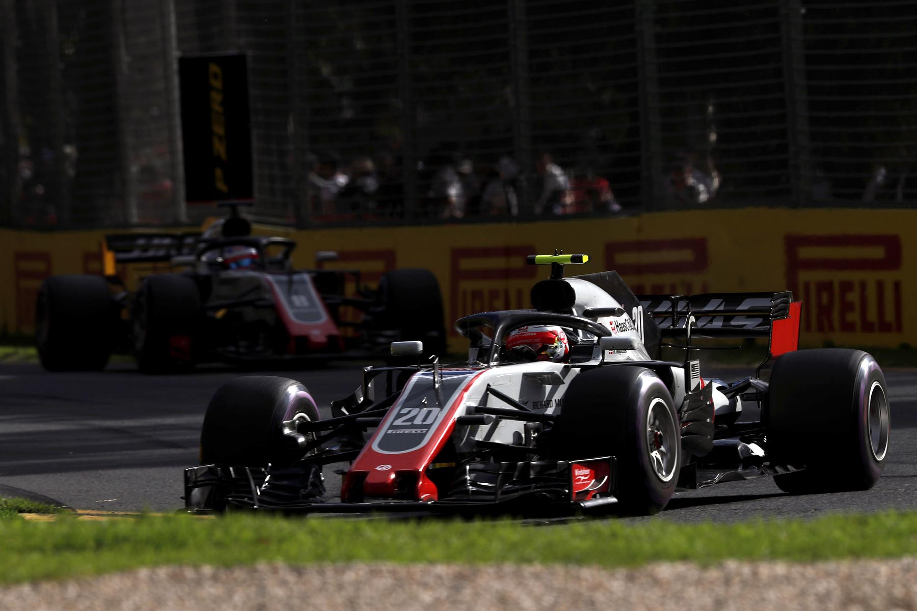 Romain Grosjean and Kevin Magnuseen on track at the 2018 Australian Grand Prix.