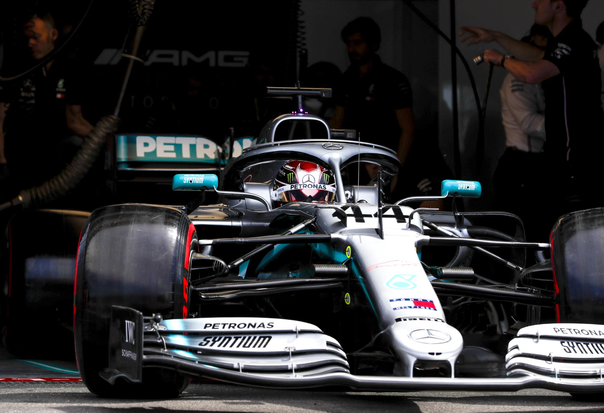 Lewis Hamilton drives out of his Mercedes garage.