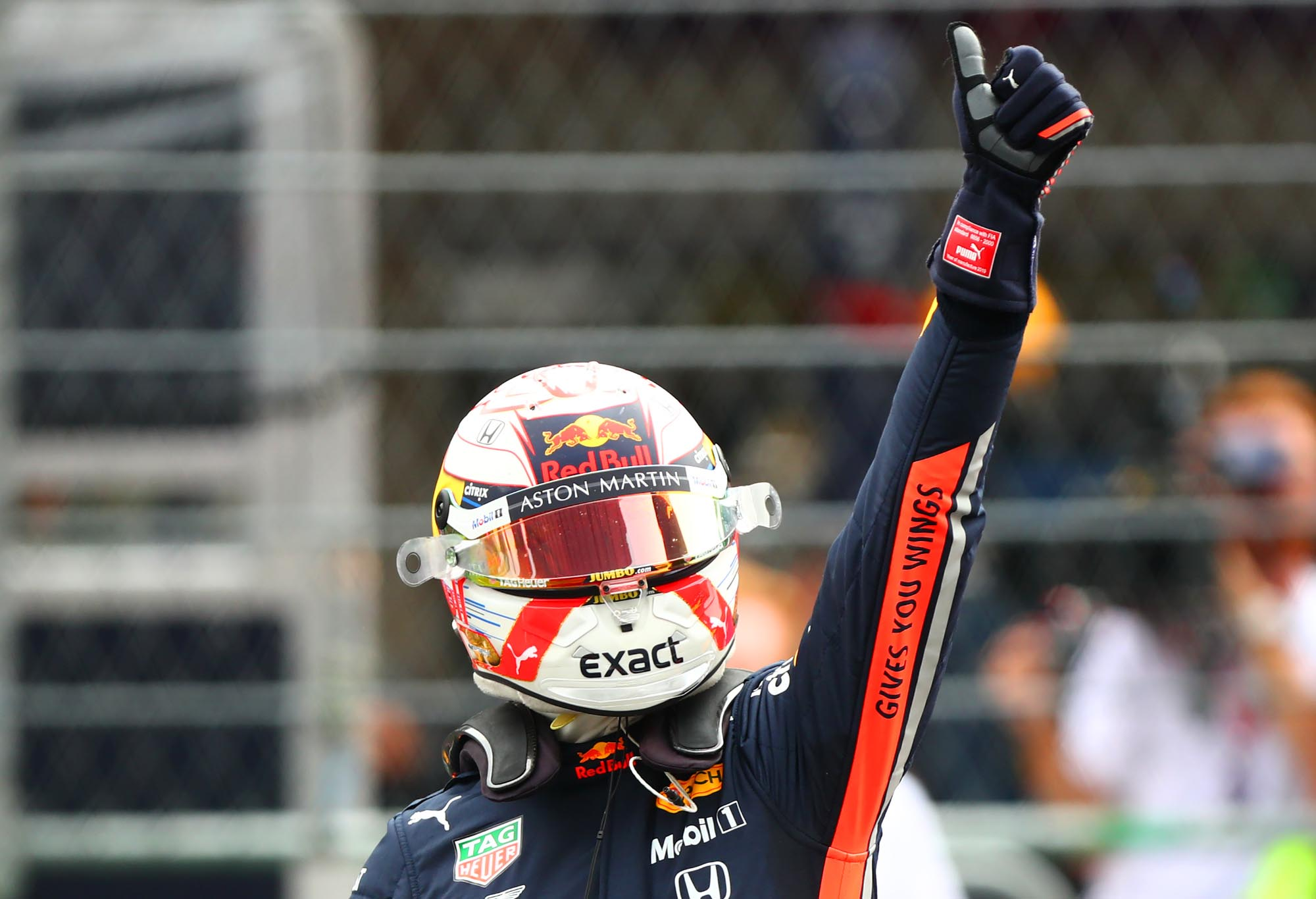 Max Verstappen gives a thumbs up to the crowd after scoring pole at the 2019 Mexican Grand Prix