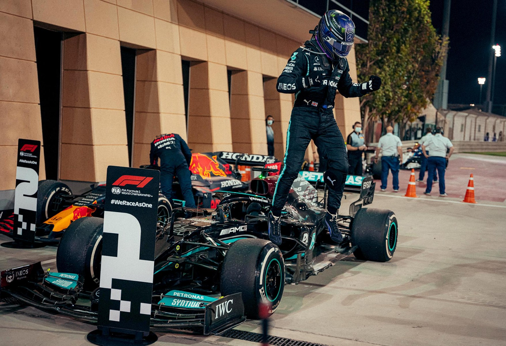 Lewis Hamilton leaps from his car