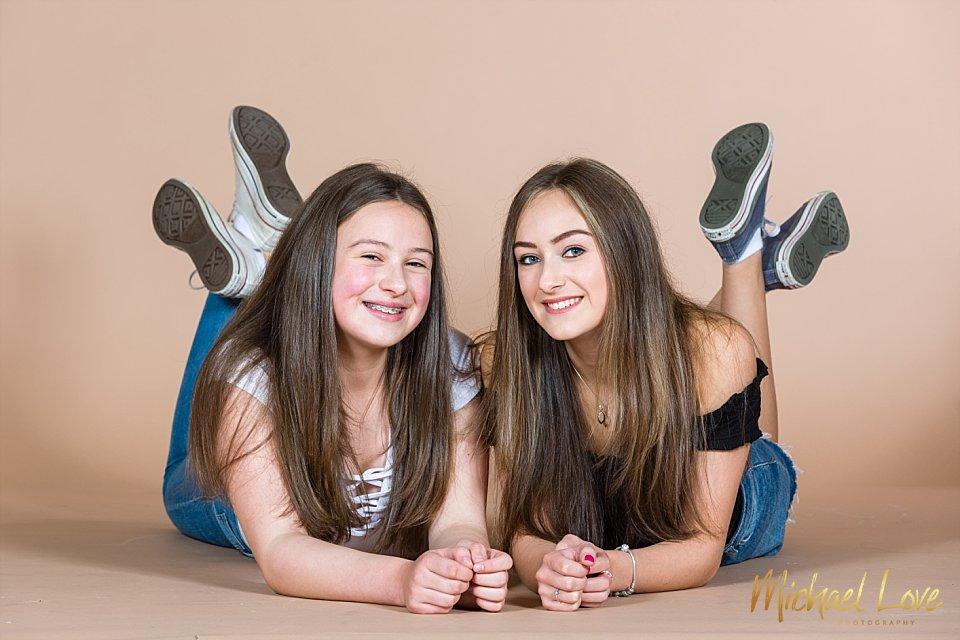 Sisters lying down in my studio in Londonderry