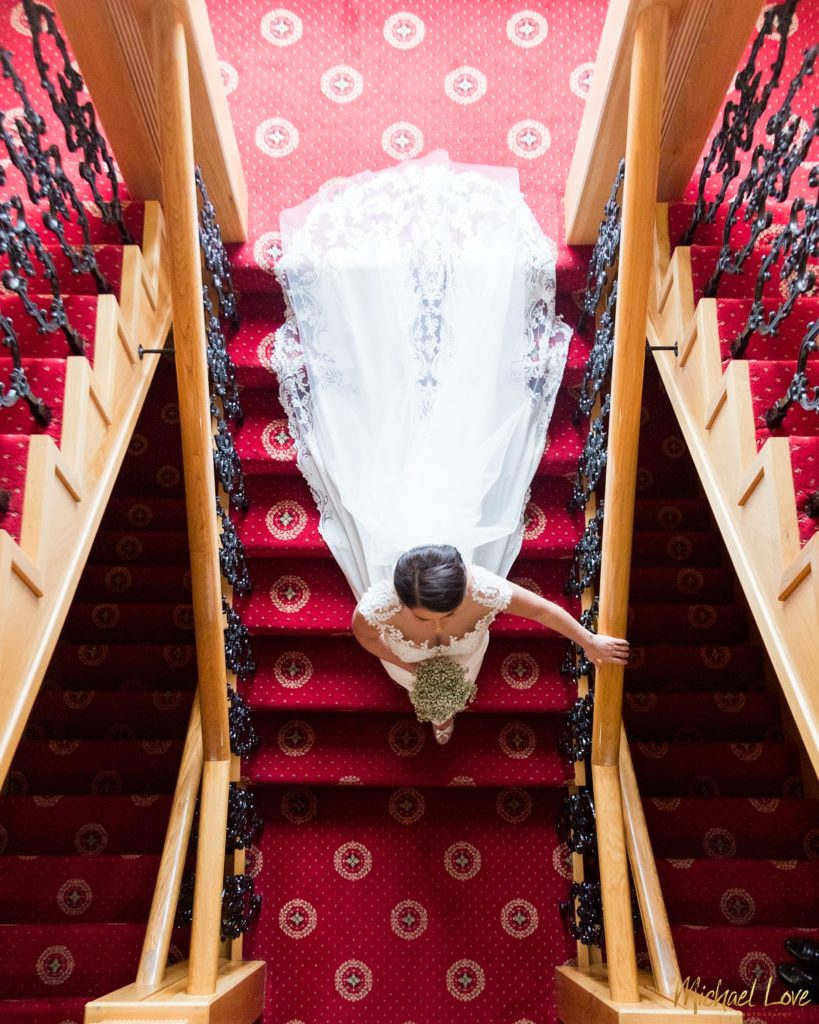 Bride walking down stairs at Ballyliffin Lodge