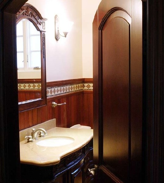 sophisticated bathroom arched doorway