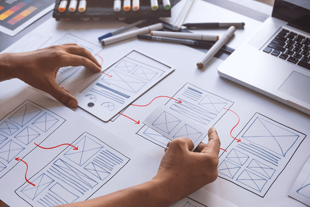 A graphic designer planning mobile design for a mobile application