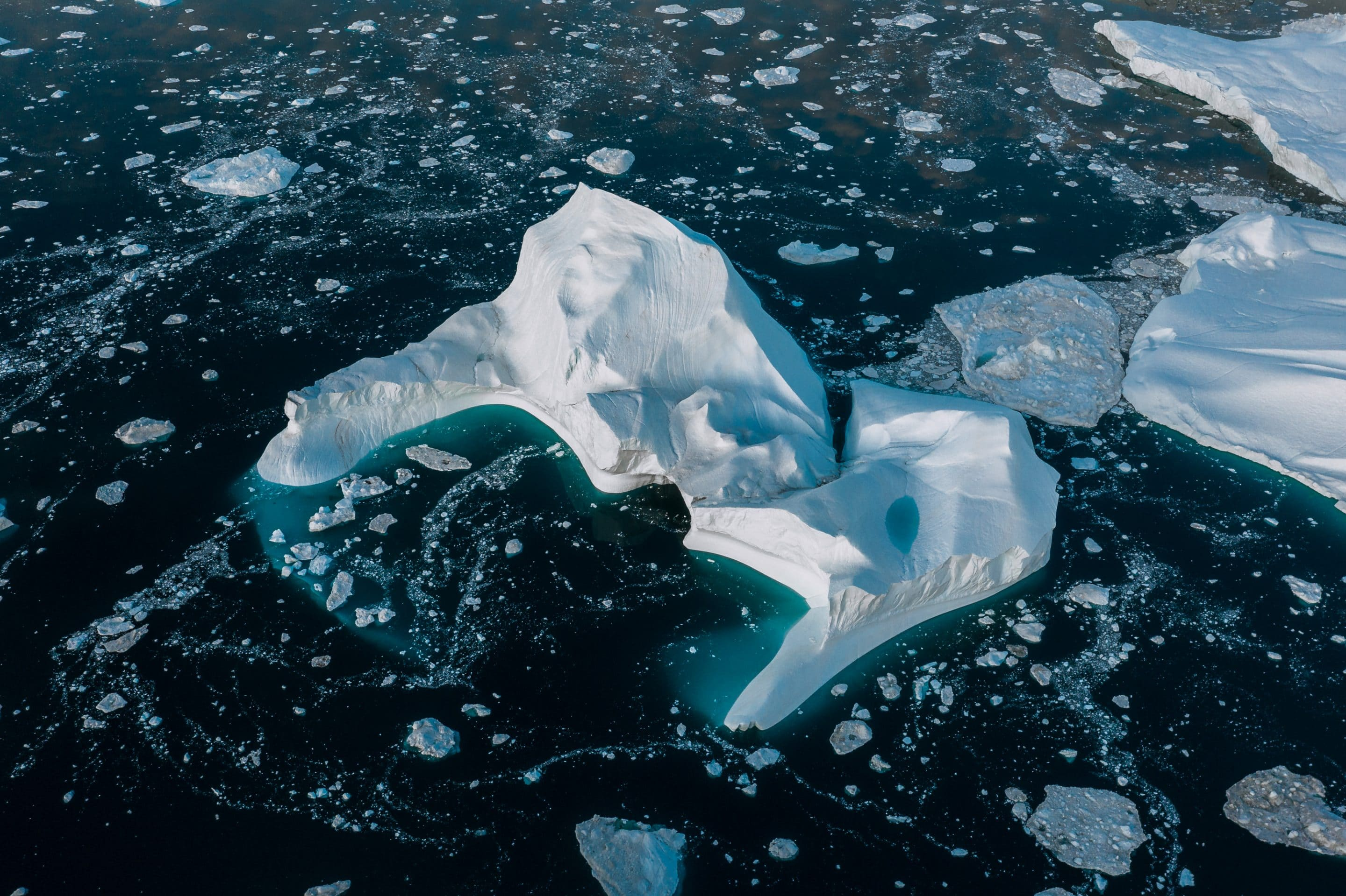 Fine Art photographer Michael Schauer captures the endlessly complex landscape of abstract shapes and forms of icebergs in the Atlantic ocean at the west Greenland coast from above with a drone