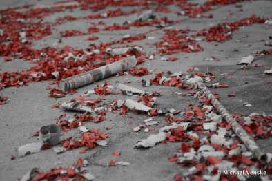 Cement littered with firecracker casings and used sparkers